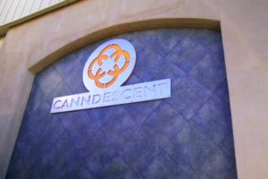 Canndescent's logo displayed outside of their Desert Hot Springs facility.